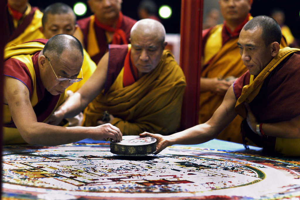 His Holiness the Dalai Lama prepares the Kalachakra mandala.
