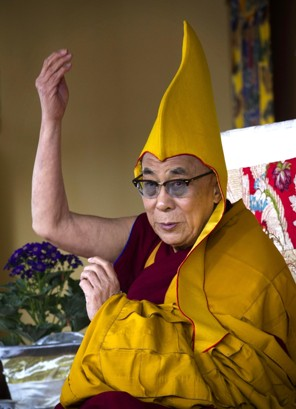 Tibetan spiritual leader the Dalai Lama wears a ceremonial yellow hat as he gives a religious talk on the 15th day of the Tibetan New Year in Dharmsala, India, Thursday, March 8, 2012 (Ashwini Bhatia – AP)