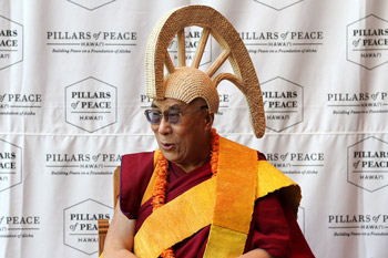 His Holiness the Dalai Lama wearing a traditional ceremonial hat at the Bishop Museum on Oahu, Hawaii, on April 14, 2012. Photo/Brian Tseng/Civic Beat