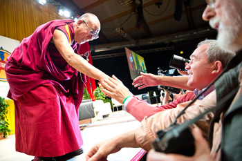 His Holiness the Dalai Lama shaking hands with members of the audience before his address in Salzburg, Austria, on May 21, 2012. Photo/Tenzin Choejor/OHHDL