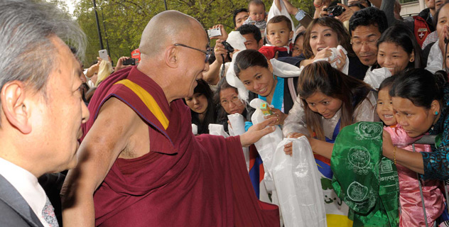 His Holiness the Dalai Lama greeting well-wishers on his arrival at his hotel in London, UK, on May 13, 2012.