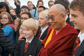 His Holiness the Dalai Lama poses for photos with a group of students after their conversation in Leeds, England, on June 15, 2012. Photo/Jeremy Russell/OHHDL