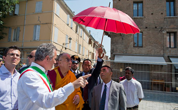 His Holiness the Dalai Lama is escorted through earthquake affected areas of Mirandola, Italy, on June 24, 2012. Photo/Tenzin Choejor/OHHDL