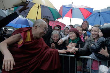 His Holiness the Dalai Lama is greeted by well-wishers on his arrival in Edinburgh, Scotland, on June 21, 2012.