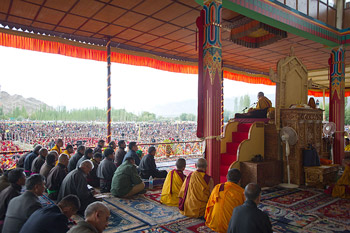 His Holiness the Dalai Lama greeting the audience at the start of his second day of teachings in Leh, Ladakh, J&K, India, on August 5, 2012. Photo/Namgyal AV Archive
