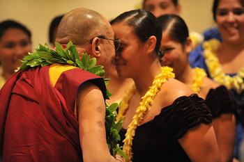His Holiness the Dalai Lama does a traditional Hawaiian Ha with a student during welcoming ceremonies on his arrival in Honolulu, Hawaii, on April 13, 2012. Photo/JHook/Civic Beat