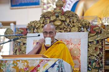 His Holiness the Dalai Lama enjoying a cup of tea during his teachings at the Main Tibetan Temple in Dharamsala, India, on October 2, 2012. Photo/Tenzin Choejor