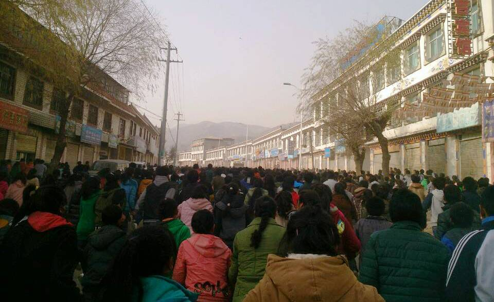 Tibetan school students carrying out a massive protest rally in Rebkong, eastern Tibet on November 9, 2012 demanding the Dalai Lama's return and freedom in Tibet.