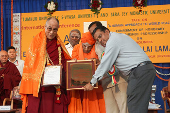 His Holiness the Dalai Lama is presented with an Honorary Distinguished Professorship from Timkur University in Bangalore, India, on November 27, 2012. Photo/Jeremy Russell/OHHDL