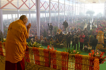 His Holiness the Dalai Lama acknowledging the audience on his arrival for the third day of his teachings in Sarnath, Uttar Pradesh, India, on January 9, 2013. Photo/Tenzin Choejor/OHHDL