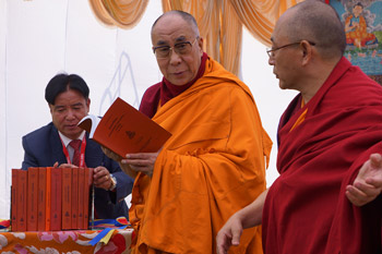 His Holiness the Dalai Lama with Ven Prof Ngawang Samten releasing new books published by the Central University for Tibetan Studies in Sarnath, Uttar Pradesh, India, on January 11, 2013. Photo/Jeremy Russell/OHHDL