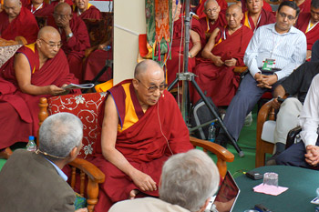His Holiness the Dalai Lama listening to a presentation by Thupten Jinpa during the second day of the Mind and Life XXVI conference held at Drepung Monastery in Mundgod, India, on January 18, 2013. Photo/Jeremy Russell/OHHDL