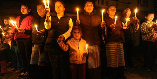 Tibetans-in-exile hold a candlelight vigil following the self-immolation attempt by a monk in Kathmandu on February 13, 2013/Getty