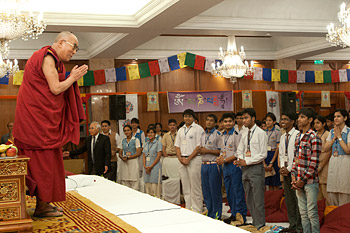 His Holiness the Dalai Lama greeting class students before their interactive session in New Delhi, India, on March 22, 2013. Photo/Tenzin Phuntsog/NAVA