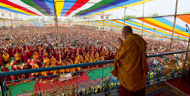 His Holiness the Dalai Lama acknowledging the crowd gathered to here his teachings in Salugara, West Bengal. Photo/Tenzin Choejor/OHHDL