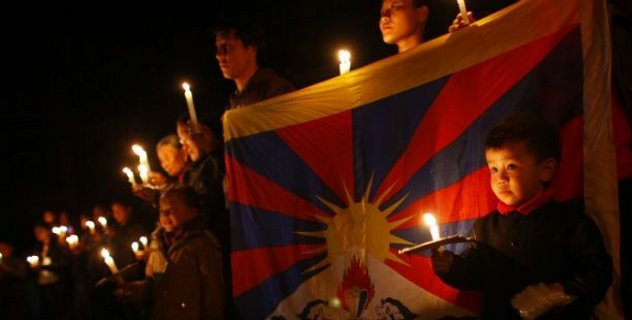 Exile Tibetans participate in a candle light vigil in solidarity with fellow Tibetans who have self immolated, in Katmandu, Nepal/AP