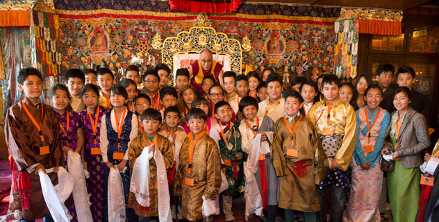 His Holiness the Dalai Lama with some of the young Tibetans who have attended programs at the Tibet Institute in Rikon, Switzerland, on April 17, 2013. Photo/Manuel Bauer