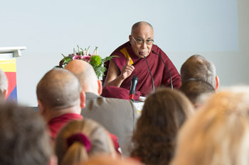 His Holiness the Dalai Lama speaking at the European Tibetan Buddhist Conference held at the Friborg Forum in Friborg, Switzerland, on April 12, 2013. Photo/Manuel Bauer