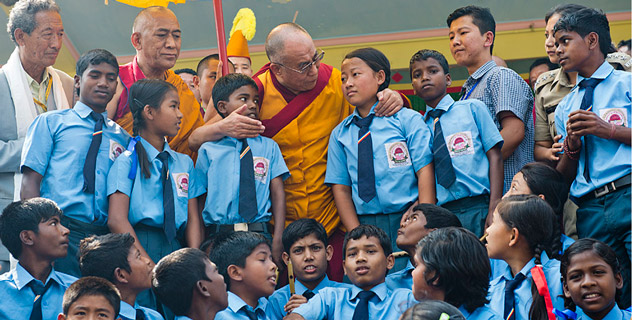 His Holiness the Dalai Lama greets students who performed on his arrival at the teaching ground in Salugara, West Bengal, on March 27, 2013. Photo/Tenzin Choejor/OHHDL