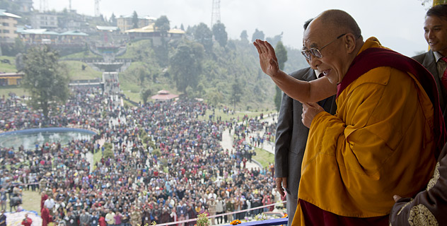 His Holiness the Dalai Lama greeting the crowd