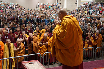 His Holiness the Dalai Lama greeting the audience on his arrival at the Alliant Energy Center in Madison, Wisconsin on May 14, 2013. Photo/Jeremy Russell/OHHDL