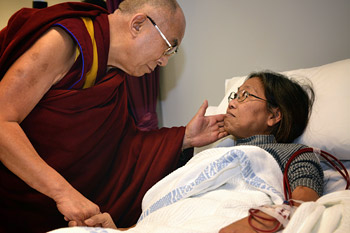 His Holiness the Dalai Lama comforts a patient during his visit to Westmead Hospital in Sydney, Australia on June 17, 2013. Photo/Rusty Stewart/DLIA 2013
