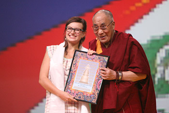 His Holiness the Dalai Lama presenting Tereze Telpe with the Dalai Lama Award for Youth Compassion at the start of his talk in Riga, Latvia on September 9, 2013. Photo/Igor/SaveTibetRussia