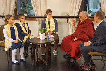 Three children conducting an interview with His Holiness the Dalai lama  for Lrytas TV in Vilnius, Lithuania on September 13, 2013. Photo/Jeremy Russell/OHHDL