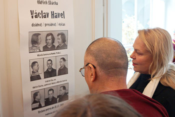 His Holiness and the late President Vaclav Havel's wife Dagmar Havlova looking at a poster depicting Vaclev Havel's arrests in his office in Prague, Czech Republic on September 16, 2013. Photo/Jeremy Russell/OHHDL