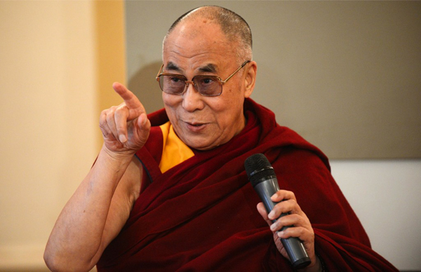Tibetan spiritual leader, the Dalai Lama gestures during his press conference at the international conference FORUM 2000 in Prague, Czech Republic, on September 17, 2013. The 17th annual Forum 2000 Conference convene global leaders from politics, academia, religion, business and civil society are meeting to discuss key issues facing civilization. The Forum 2000 Foundation was founded in 1996 by Czech President Vaclav Havel, Japanese philanthropist Yohei Sasakawa, and Nobel Peace Prize laureate Elie Wiesel. According to the organization, the main objective of its conferences is 'to identify the key issues facing civilization and to explore ways to prevent the escalation of conflicts that have religion, culture or ethnicity as their primary components. (EPA Photo)