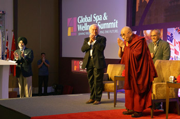 His Holiness the Dalai Lama greeting the audience at the start of his talk at the the Global Spa and Wellness Summit in Guragon, India on October 6, 2013. Photo/Jeremy Russell/OHHDL