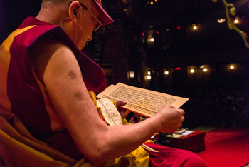 His Holiness the Dalai Lama reading from a Tibetan text during his teachings at the Beacon Theater in New York City, NY, USA on October 18, 2013. Photo/Robert Nickelsberg