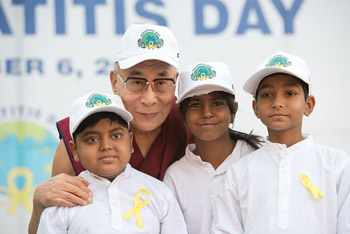 His Holiness the Dalai Lama with three young liver transplant patients who performed a song before his talk at the Institute of Liver and Billary Science in New Delhi, India on December 6, 2013. Photo/Tenzin Choejor/OHHDL