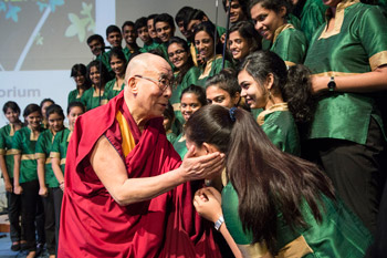 "His Holiness the Dalai Lama greeting members of the Christ University Choir after their performance at the start of the conference on ""Bounds of Ethics in a Globalized World"" at Christ University in Bangalore, India on January 6, 2014. Photo/Tenzin Choejor/OHHDL"