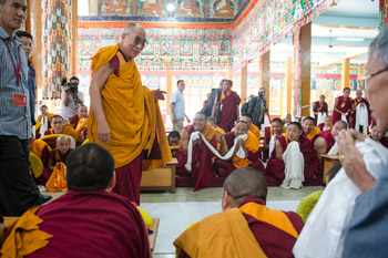 His Holiness the Dalai Lama greeting the gathering as he arrives at the Sera Lachi Temple at Sera Monastery in Bylakuppe, Karnataka, India on December 24, 2013. Photo/Tenzin Choejor/OHHDL