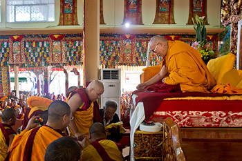 His Holiness the Dalai Lama accepting a mandala offering from H.E. Ling Choktrul Rinpoche on the first day of the Lam Rim teachings at Sera Monastery in Bylakuppe on December 25, 2013. Photo/Rio Helmi