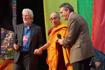 His Holiness the Dalai Lama is accompanied by actor Richard Gere as he arrives on stage at the Arena Ciudad de Mexico at the start of his teachings in Mexico City, Mexico on October 12, 2013. Photo/Jeremy Russell/OHHDL