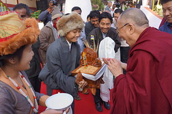 His Holiness the Dalai Lama receiving a traditional welcome on his arrival at the Chowkur Tibetan Settlement in Periyapatna, Karnataka, India on January 4, 2014. Photo/Jeremy Russell/OHHDL