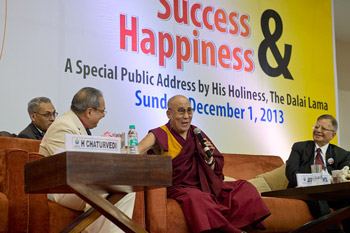 """His Holiness the Dalai Lama answering questions from the audience during his talk on """"Success & Happiness"""" in Noida, India on December 1, 2013. Photo/Tenzin Choejor/OHHDL"""