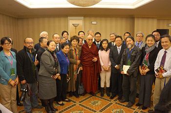 His Holiness the Dalai Lama with a group of Chinese scholars and writers after their meeting in New York on October 21, 2013. Photo/Jeremy Russell/OHHDL