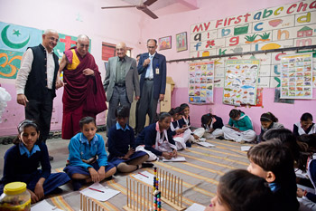 Harsh Mander and His Holiness the Dalai Lama visiting a classroom at the Care Home for Street Children in Mehrauli, New Delhi, India on December 7, 2013. Photo/Tenzin Choejor/OHHDL