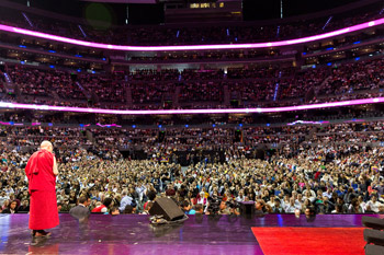 His Holiness the Dalai Lama greeting a capacity crowd of 15,000 before his talk at Arena Ciudad de Mexico in Mexico City, Mexico on October 13, 2013. Photo/Oscar Fernandez