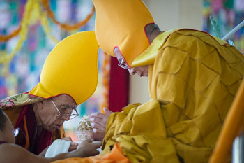 Ganden Tripa Rizong Rinpoche making traditional offerings at the start of His Holiness the Dalai Lama's final day of teachings at Sera Jey Monastery in Bylakuppe, Karnataka, India on January 3, 2014. Photo/Tenzin Choejor/OHHDL