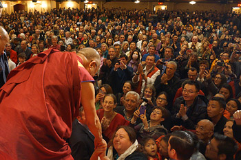 His Holiness the Dalai Lama shaking hands with members of the audience at the conclusion of his talk at the Beacon Theater in New York on October 20, 2013. Photo/Jeremy Russell/OHHDL
