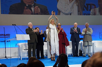 Sharon Stone holds up the Peace Summit Award she received at the 13th World Summit of Nobel Peace Laureates in Warsaw, Poland on October 23, 2013. Photo/Jeremy Russell/OHHDL