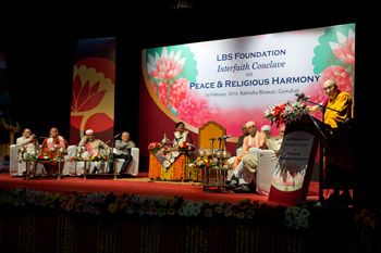 His Holiness the Dalai Lama speaking at the Interfaith Conclave on Peace and Religious Harmony in Guwahati, Assam, India on February 1, 2014. Photo/Tenzin Choejor/OHHDL