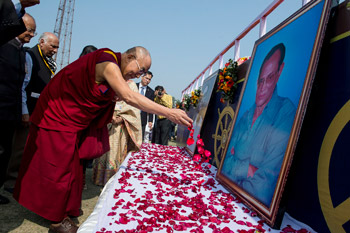 His Holiness the Dalai Lama offers floral tribute to the two founders of LBS before his talk at Nehru Stadium in Guwahati, Assam, India on February 2, 2014. Photo/Tenzin Choejor/OHHDL
