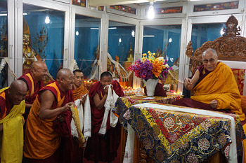 His Holiness the Dalai Lama shares a moment of laughter with the monks at Ganden Choling in Lamparing, Meghalaya, India on February 4, 2014. Photo/Jeremy Russell/OHHDL