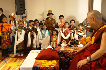 Young children singing for His Holiness the Dalai Lama at the start of his meeting with members of the Tibetan community in Los Angeles, California on February 27, 2014. Photo/Jeremy Russell/OHHDL