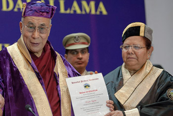 Himachal Pradesh Governor Urmila Singh presenting His Holiness the Dalai Lama with an honorary degree from Himachal Pradesh University in Shimla, India on March 19, 2014. Photo/Tenzin Choejor/OHHDL